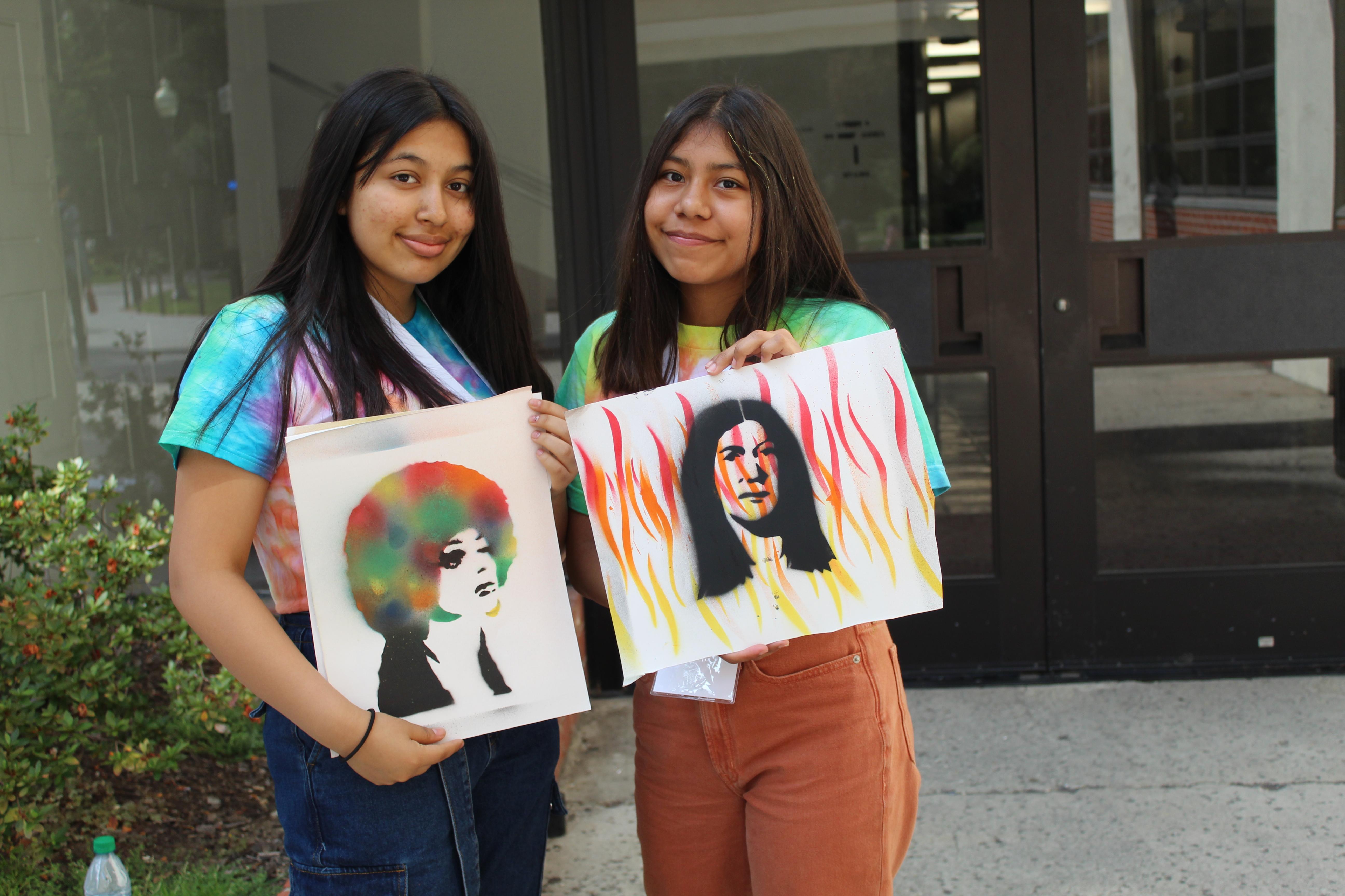 Youth stenciling at Activist Camp
