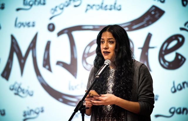 Trans Latinx organizer, Isa Noyola speaking in front of the Mijente logo