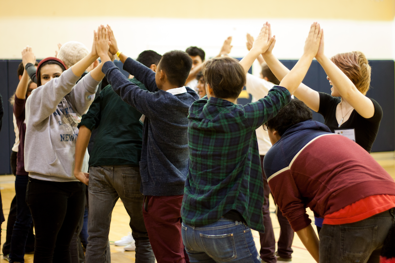 Trans & queer young people do a group activity at YES 2015