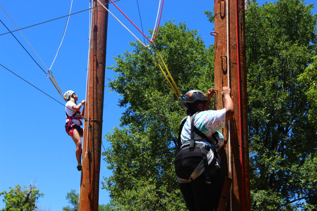 LGBTQ youth climbing during ropes course