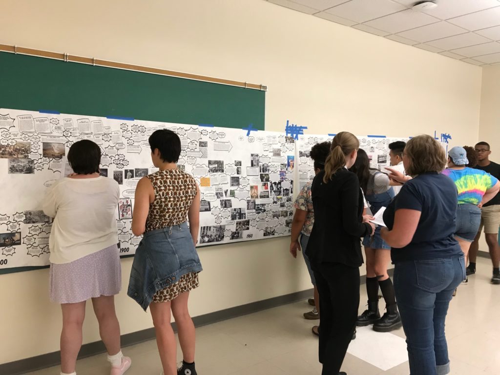Youth look at a timeline of LGBTQ history